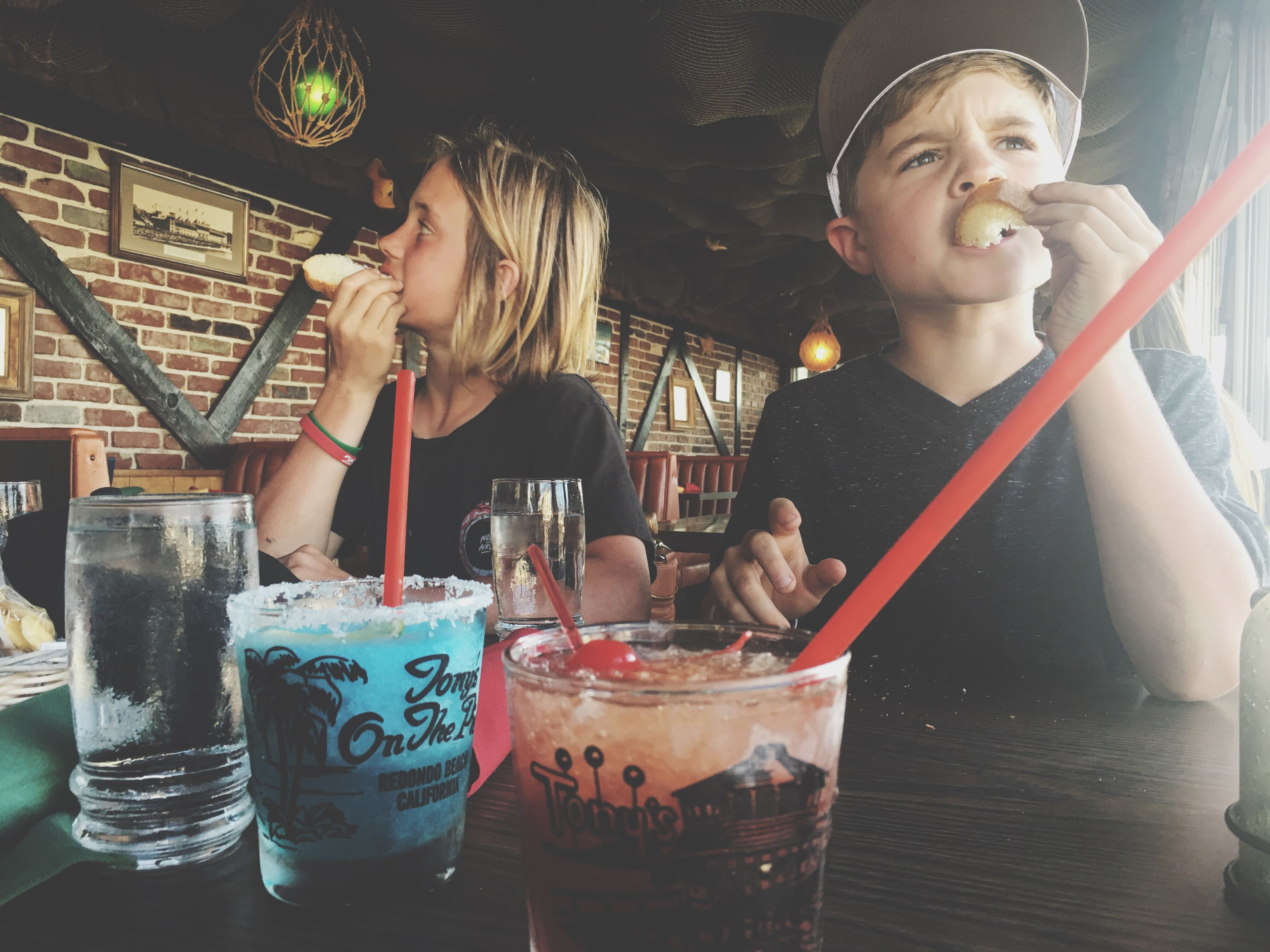 food and drink, drink, togetherness, celebration, lifestyles, sitting, leisure activity, refreshment, in front of, beverage, person, freshness, nightlife, young adult
