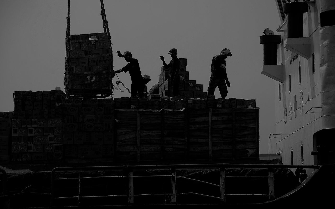 Variety of activities of loading and unloading of goods at the Port of Sunda Kelapa in Jakarta Activities Adult Adults Only Architecture Built Structure Clear Sky Day Harbor Jakarta Loading Dock Low Angle View Outdoors People Port Portrait Sculpture Sky Statue Unloading
