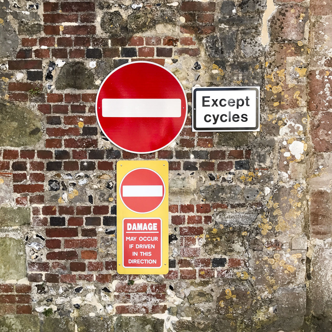 Traffic signs Architecture Brick Wall Bricks Building Communication Directions Do Not Enter Sign Forbidden Guidance No People Notice Old Outdoors Restriction Restrictions Road Sign Sign Signs Stop Sign Traffic Sign Warning Sign