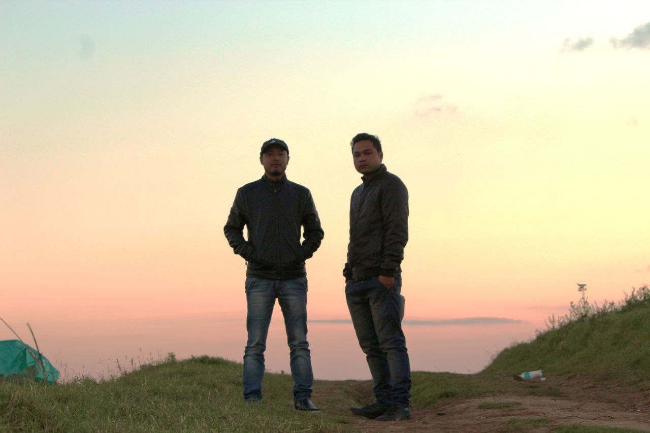 Into the horizon was the sun setting and 2 of my friends in the frame. 2 Freinds Friendship Full Length Grass Men Only Men Outdoors People Sky Standing Sunset