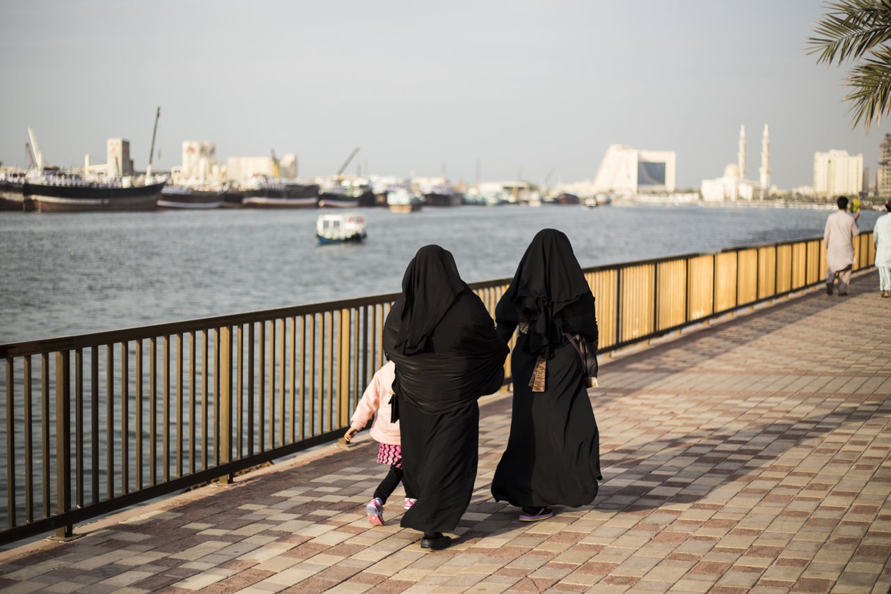 Adult Burqa Chador Day Full Length Lifestyles Outdoors People Real People Rear View Sea Sky Streetphotography The Street Photographer - 2017 EyeEm Awards Traditional Clothing Two People Water Women