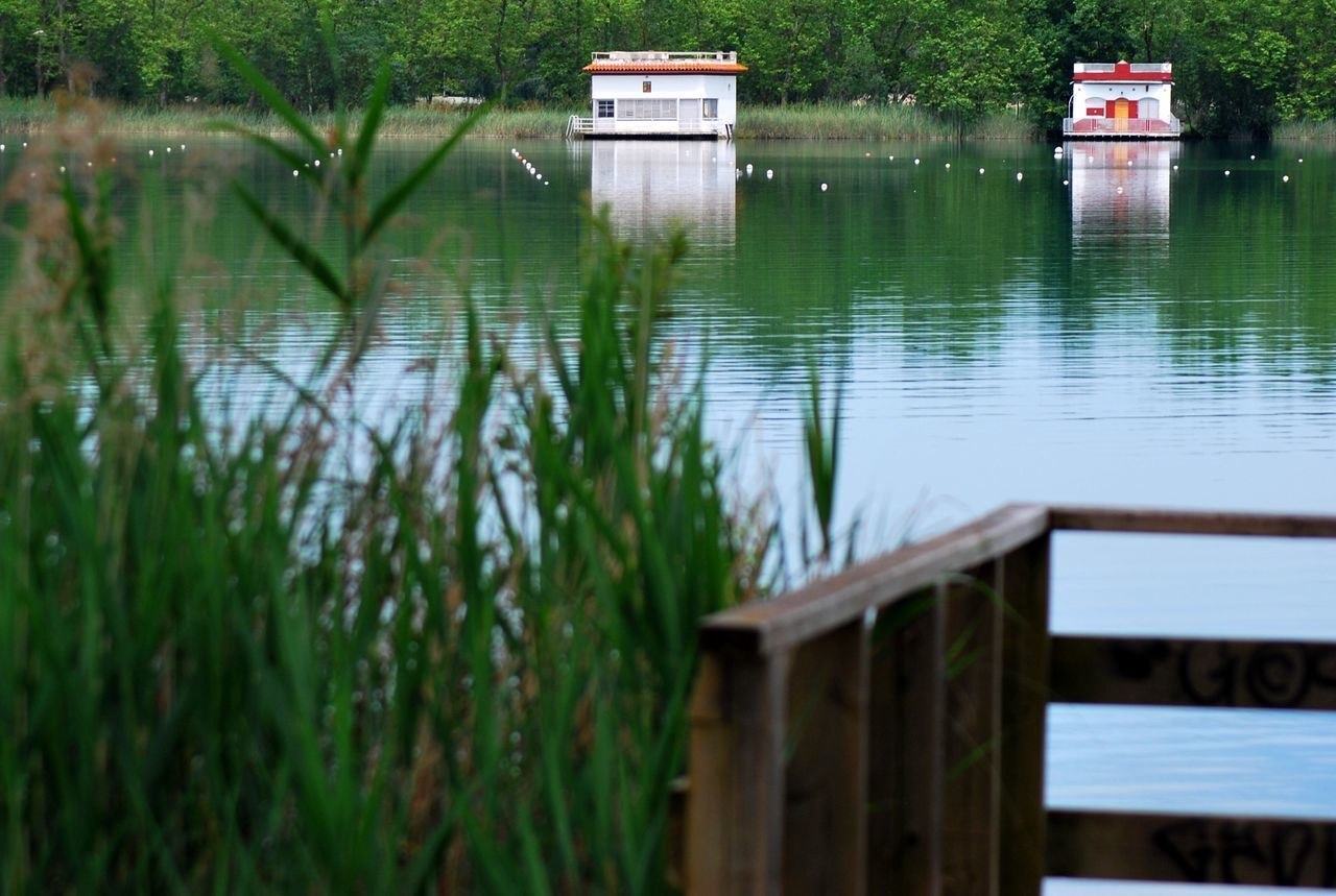 water, lake, nature, no people, wood - material, tranquility, outdoors, built structure, day, tranquil scene, grass, beauty in nature, architecture, scenics
