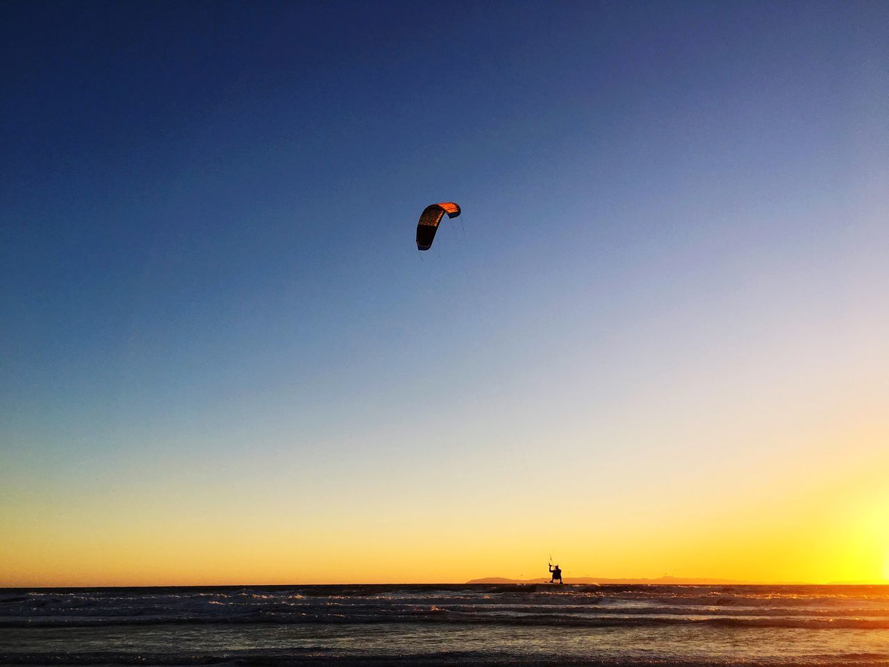 Kite boarding Sea Unrecognizable Person Adventure Lifestyles Beauty In Nature Nature Leisure Activity Horizon Over Water Scenics Water Extreme Sports One Person Silhouette Sky Outdoors Clear Sky Kiteboarding Sunset