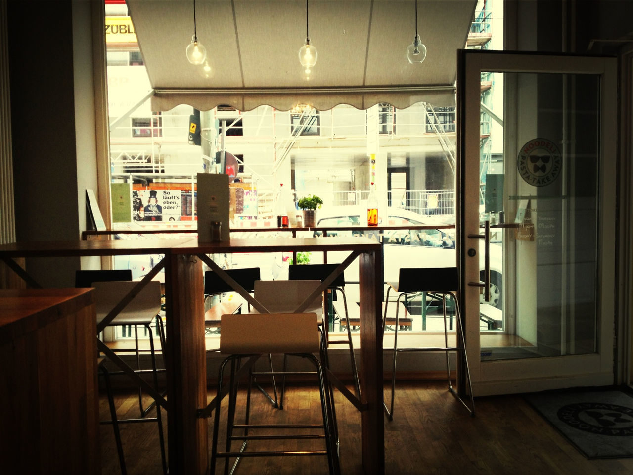 indoors, chair, table, restaurant, cafe, home interior, window, home showcase interior, no people, architecture, day, furniture, built structure, open door