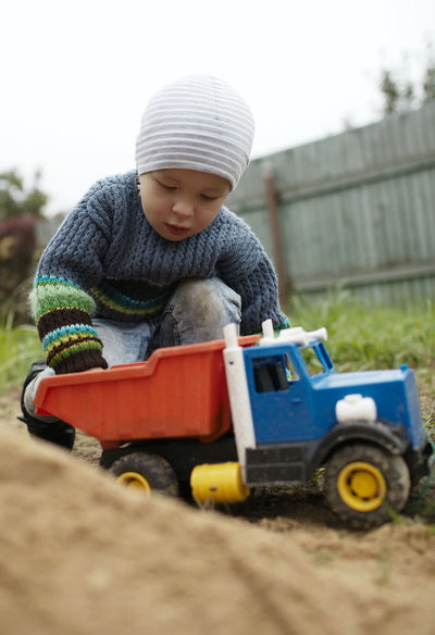 Boy Car Caucasian Child Childhood Countryside Dacha Game Indoors  Kid Leisure Little Machine Outdoors Play Playful Roll Russia Sand Son Toy Truck