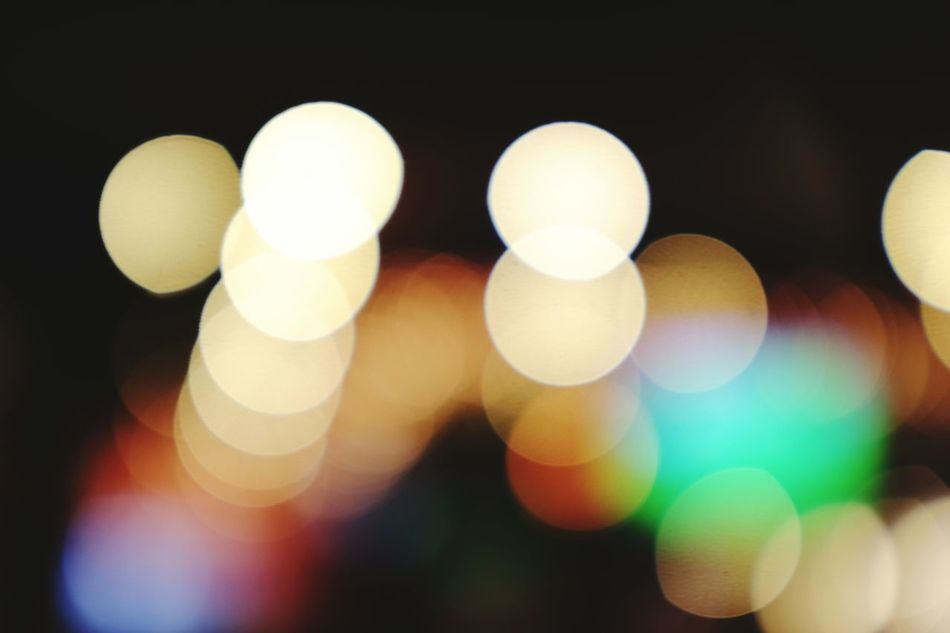Who can say no to bokeh? Illuminated Defocused Glowing Night Black Background Pattern Abstract Lighting Equipment Backgrounds No People Light Bulb Nightlife Light Effect Close-up Shiny Outdoors Fresh On Eyeem  Bokeh Bokehlicious Bokeh Balls Cinematic MOVIE