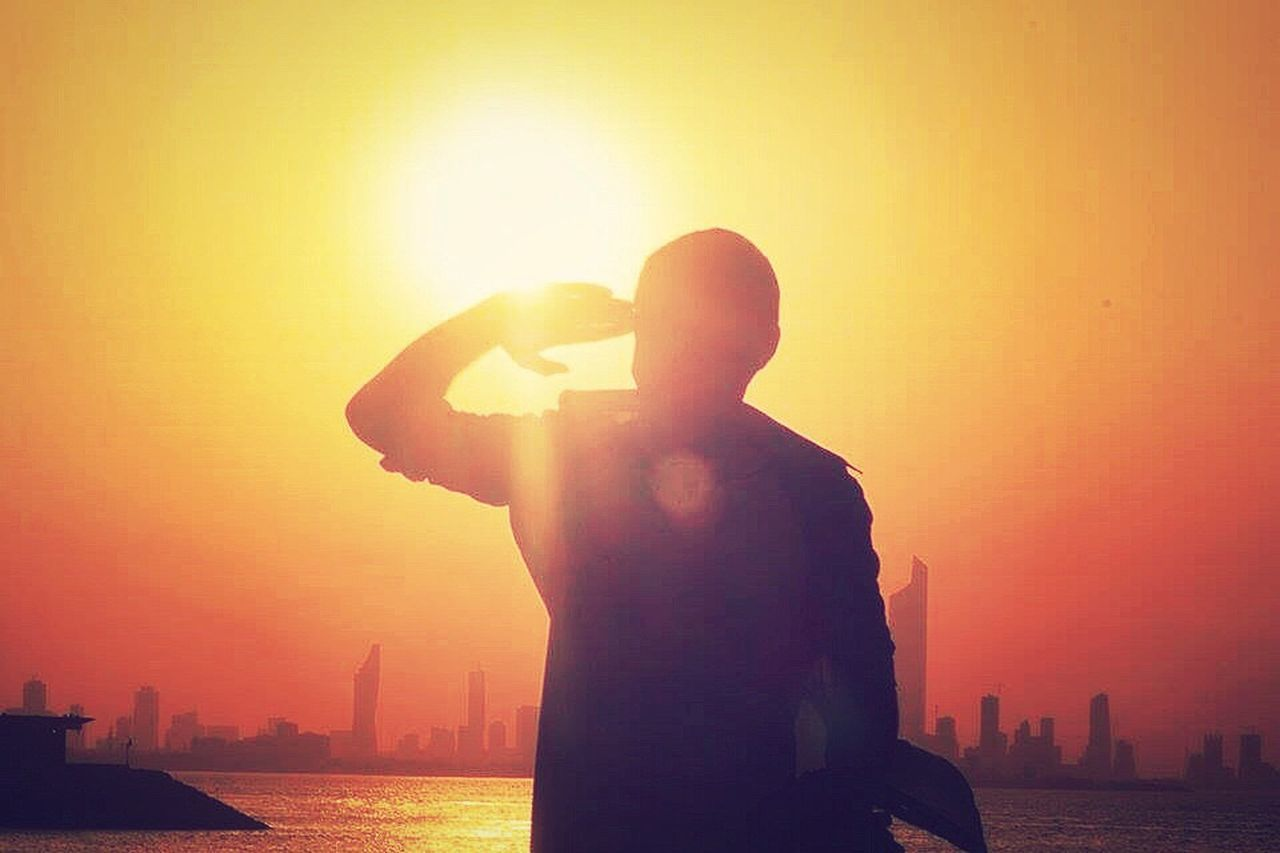 The unknown salutation. Sunset One Person One Man Only Lens Flare Men Standing Only Men Adults Only Silhouette Silhoutte Photography Kuwait City Nature Salute Natural Sky Sun Real People City Adult People Day Fresh On Eyeem