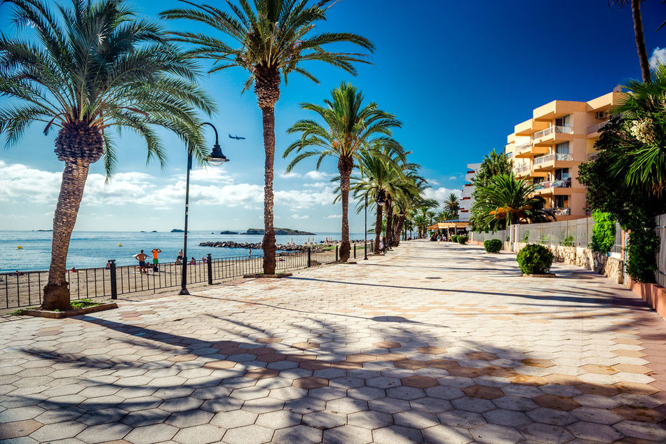 View of Ibiza seafront. Spain Balearic Islands Beauty In Nature Cloud Eivissa Europe Footpath Ibiza Landscape Mediterranean Sea Nature Outdoors Palm Trees Pedestrian Walkway Promenade Sea Seafront Seaside SPAIN Summer Sunny Day Tourism Town Travel Destinations Tropical Climate Walkway