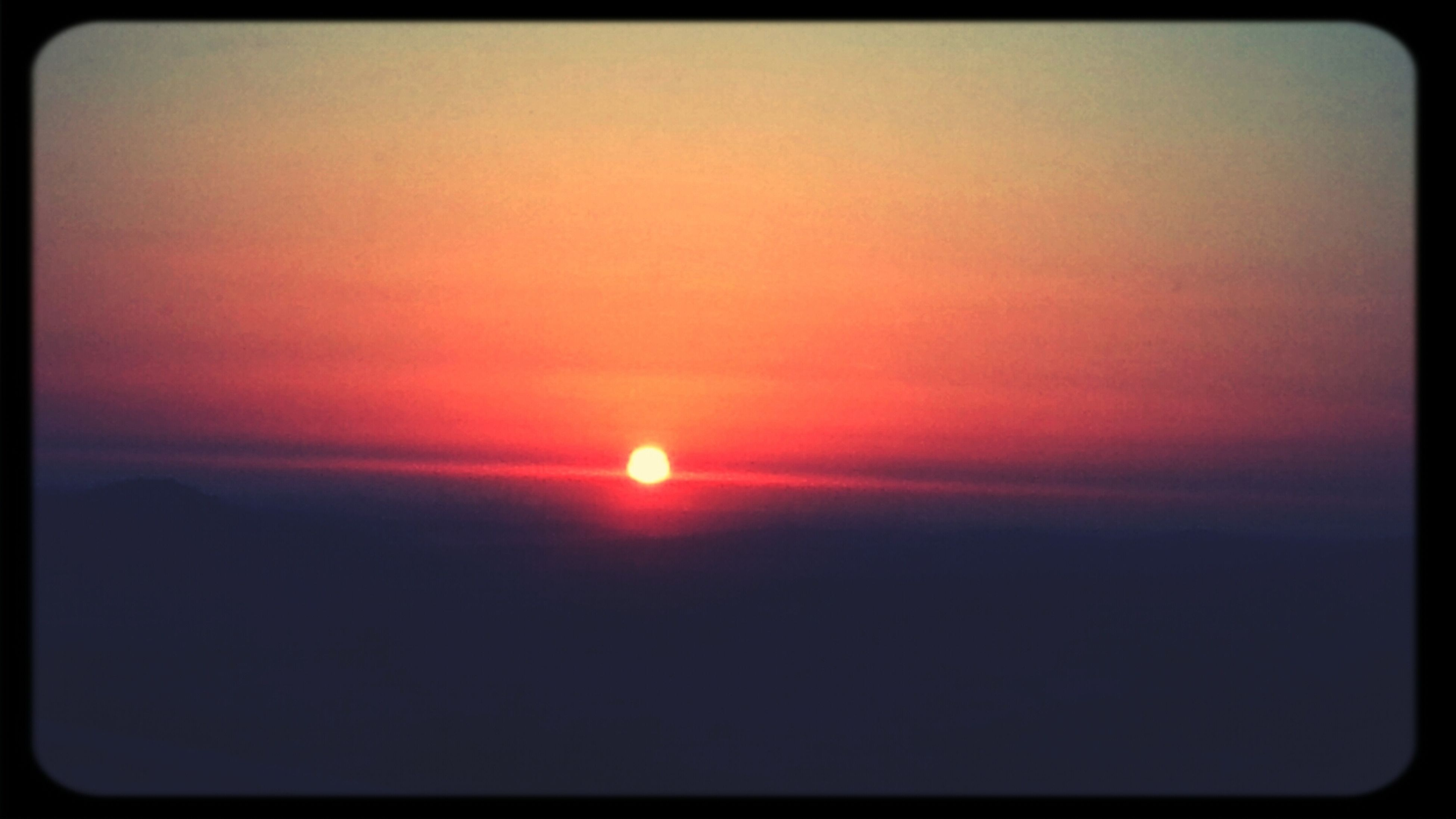 sunset, transfer print, sun, scenics, tranquil scene, beauty in nature, orange color, tranquility, auto post production filter, idyllic, sky, nature, silhouette, copy space, sunlight, outdoors, landscape, no people, majestic, cloud - sky