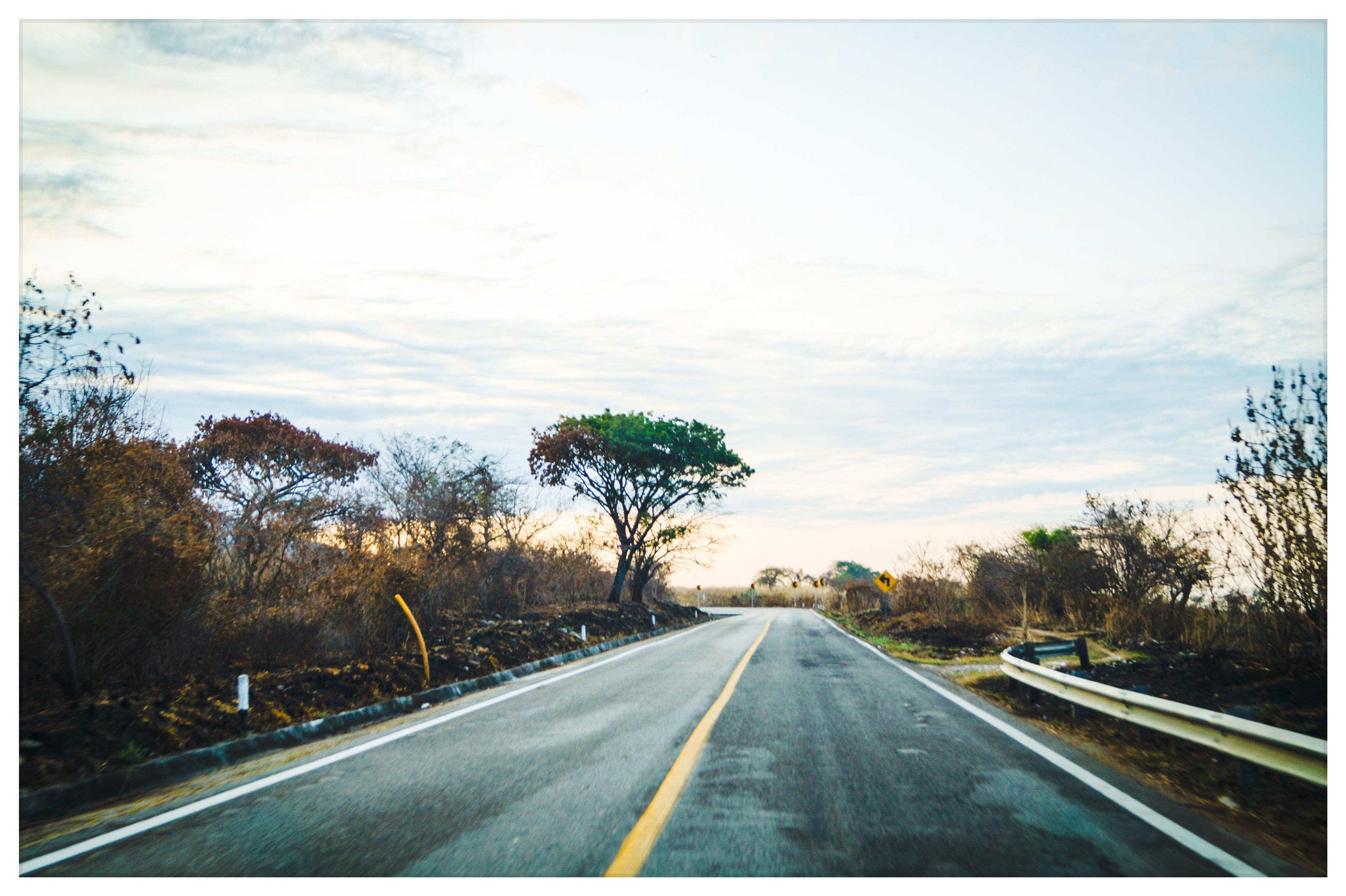 transportation, the way forward, road, diminishing perspective, road marking, vanishing point, sky, transfer print, tree, cloud - sky, country road, car, auto post production filter, highway, cloud, long, empty road, windshield, nature, cloudy