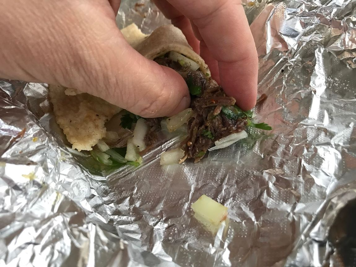 Food tastes better when eaten by hand. Hand Food Finger Eating Barbacoa Taco Tacos Cilantro Onions Aluminium Foil Foil  Gorilla Eating Human Hand Food And Drink Close-up No Faces