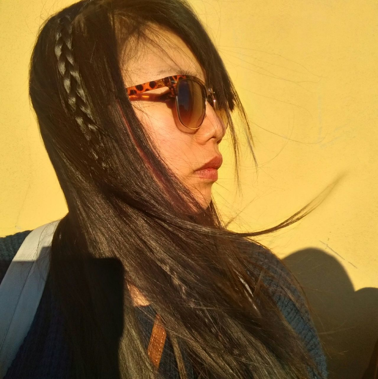 Close-Up Of Young Woman Wearing Eyeglasses With Long Black Hair