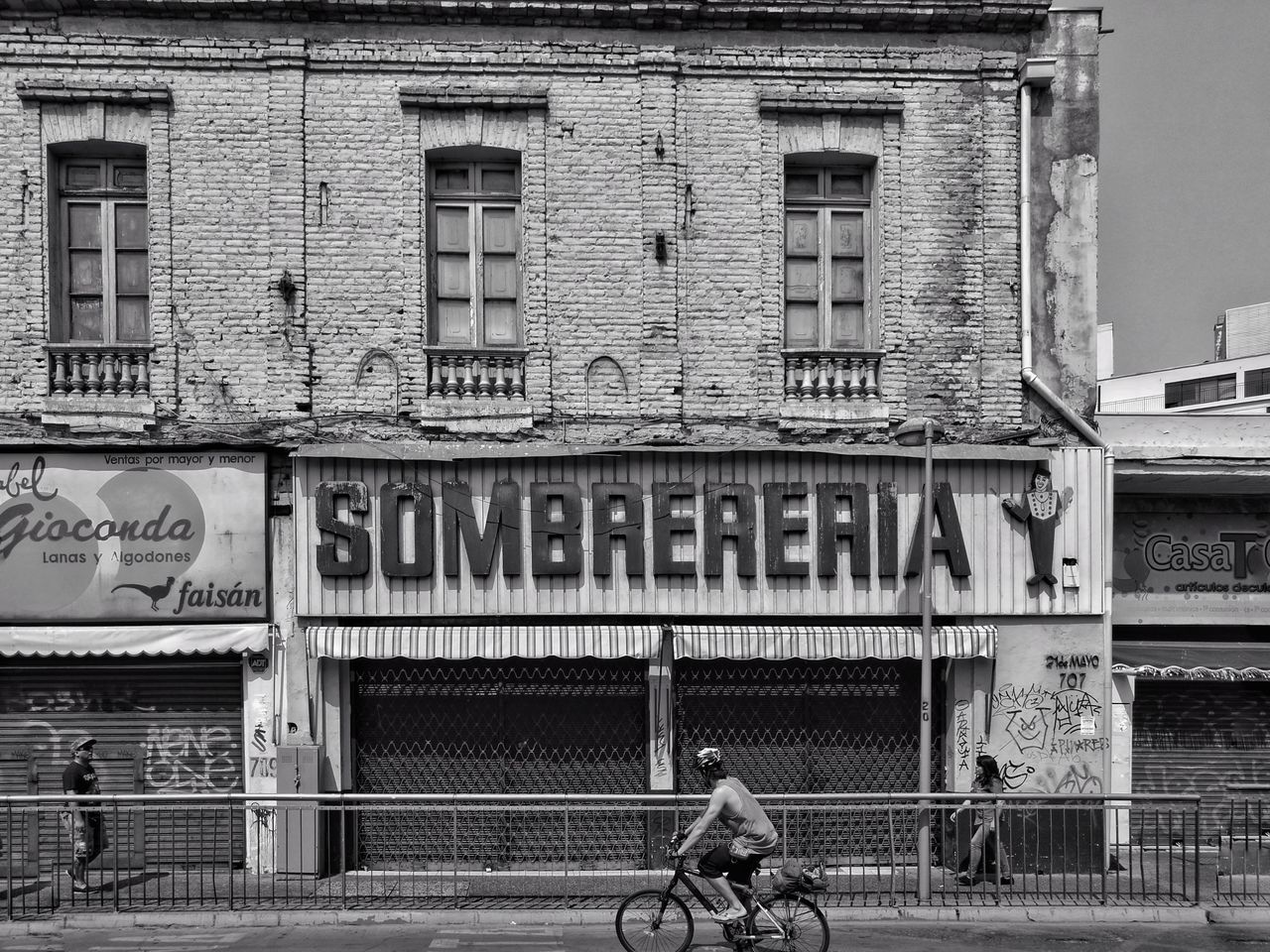Sombrereria Building Exterior Architecture Real People Men Adult People Street Photography Streetphoto Santiago De Chile Streetphoto_bw Blancoynegro Streetphotography Bicycle Ciclismo Cicling