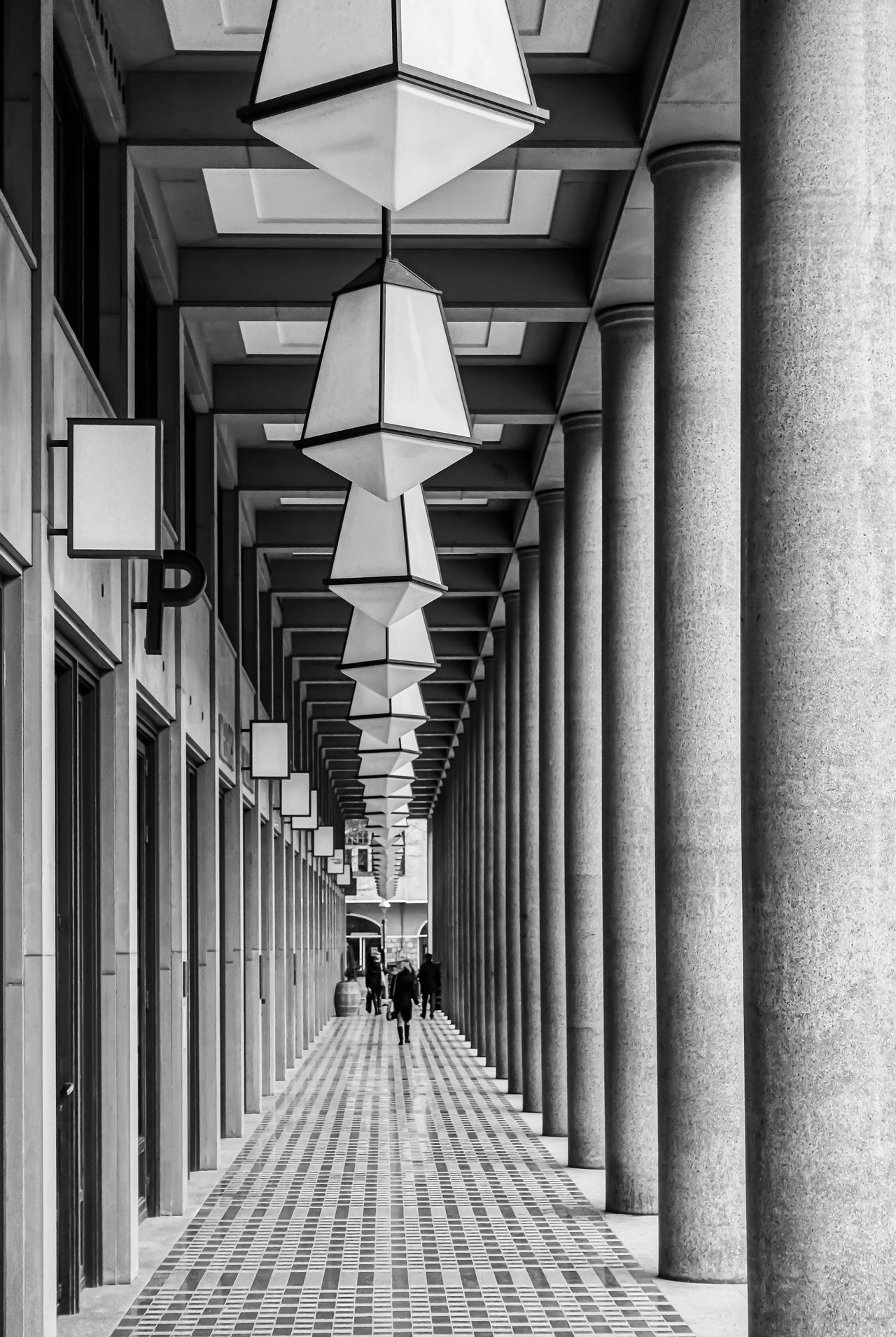 Black & White Colonnade Modern Architecture Arcade Architectural Column Architecture Black And White Built Structure Corridor Day In A Row Indoors  One Person People Pillars Real People The Way Forward Walking
