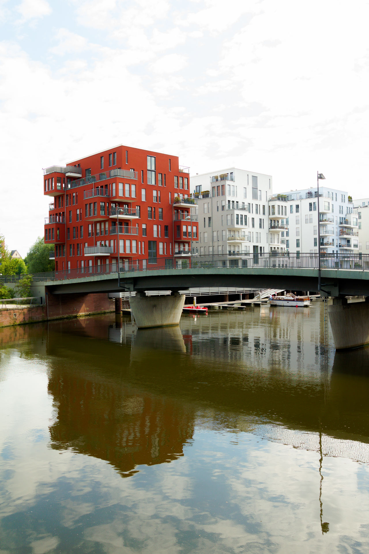 Westhafen Architecture Bridge - Man Made Structure Building Exterior Built Structure City Cloud - Sky Connection Day Ferry No People Passenger Craft Red Reflection Residential Building Residential District River Riverbank Sky Transportation Water Waterfront Westhafen