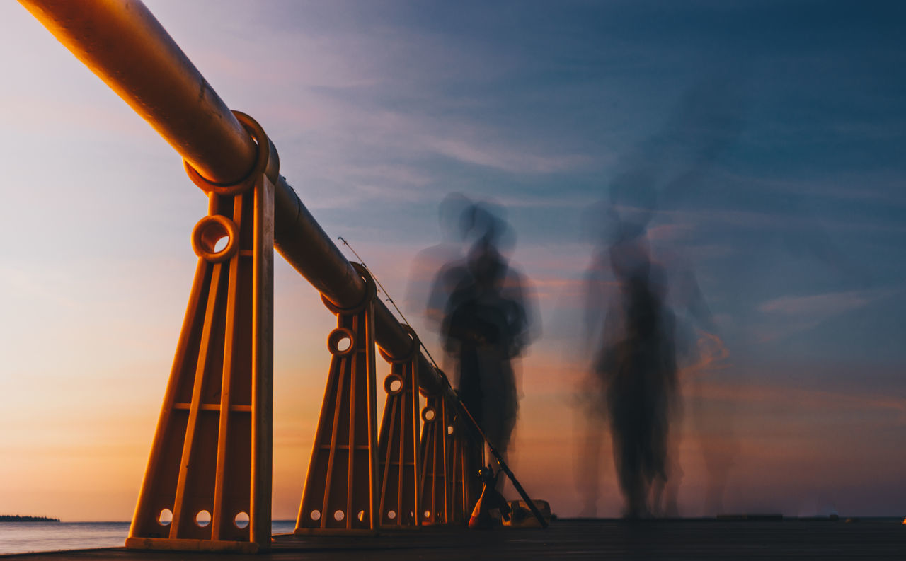 shadow of the setting sun Light painting Low exposure built structure cloud - sky day low section men Nature one person outdoors real people sea shadow shadow photography sky slow shutter sunset two persons water women EyeEmNewHere Connected by Travel