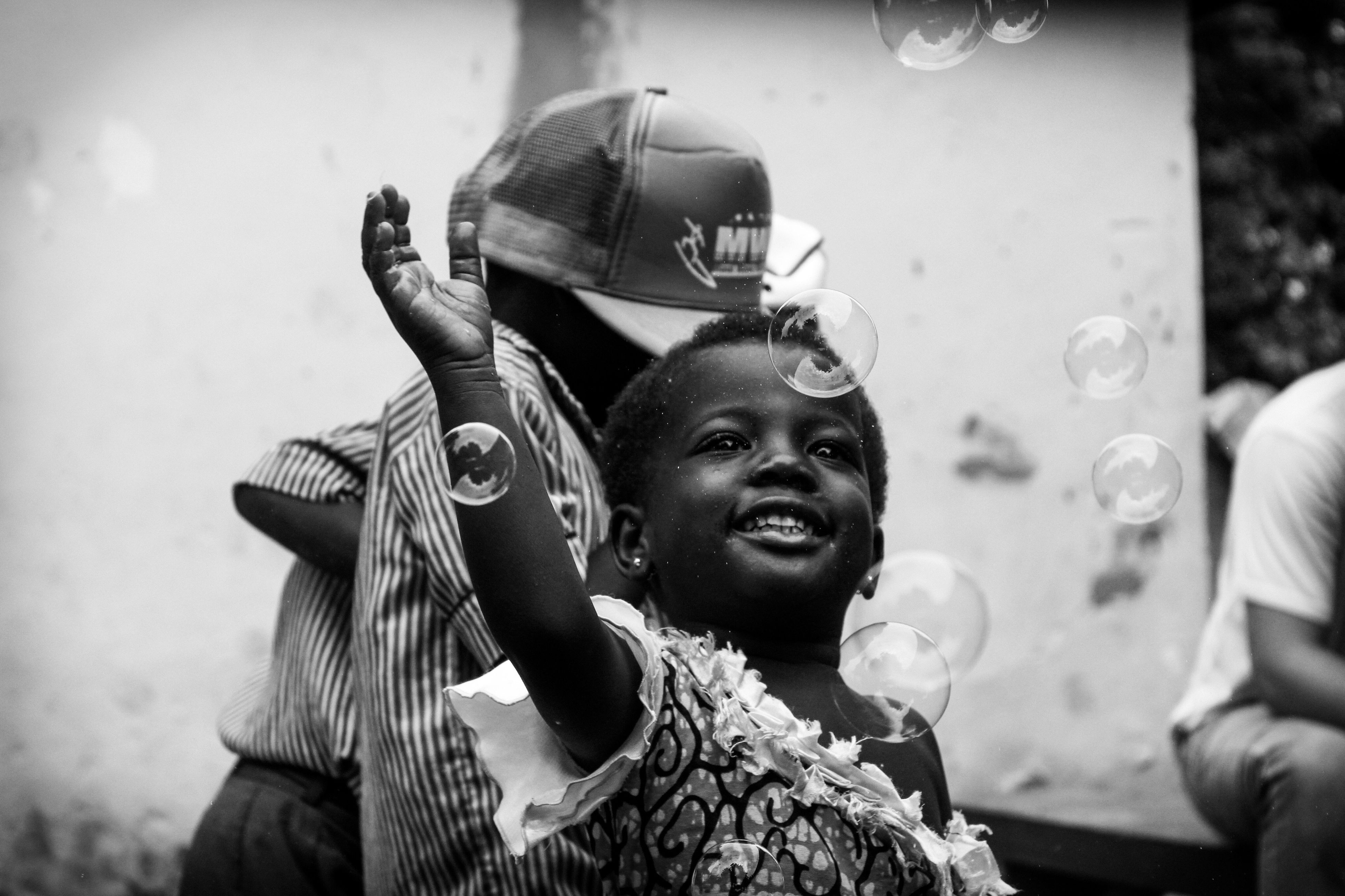 real people, holding, leisure activity, young adult, young women, lifestyles, front view, focus on foreground, headshot, outdoors, standing, young men, day, happiness, human hand, close-up, bubble wand, people