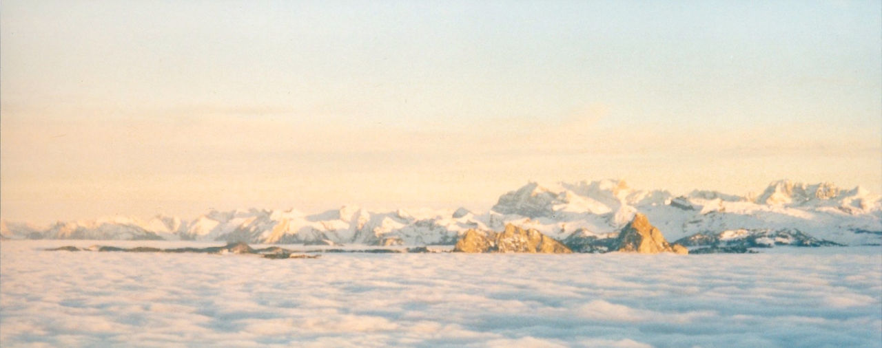 Cloud lake in the Swiss alps Beauty In Nature Cloudcover Cloudcoveredmountain Clourful Sky Impressionism Landscape Outdoors Scenics Sky Snow Sunset Tranquility Winter