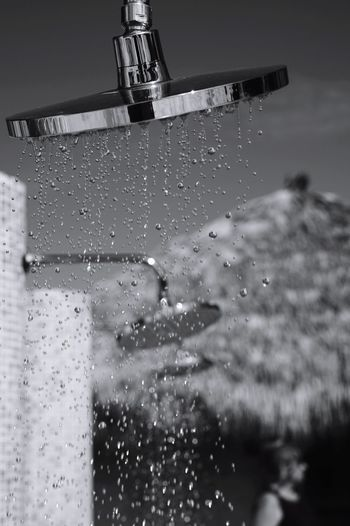 outdoor shower at the beach Vacation Holiday Canadian Sony Fullframe Family Beach Photography Blackandwhite Monochrone Bnw Caribbean Hut Water Shower Contrast Water Day No People Outdoors Nature Close-up Sky