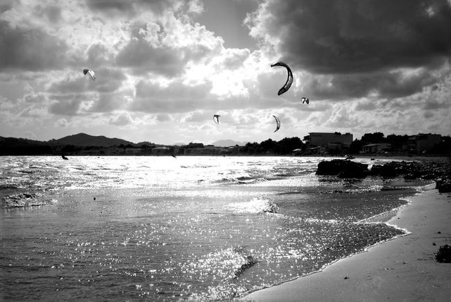 Kitesurfing Sea Water Sky Nature Beach Beauty In Nature Scenics Cloud - Sky Mountain Outdoors Horizon Over Water Wave Adventure Kiteboarding No People Day Extreme Sports Paragliding Parachute Alcudia Mallorca Kitesurfing Blackandwhite Black & White