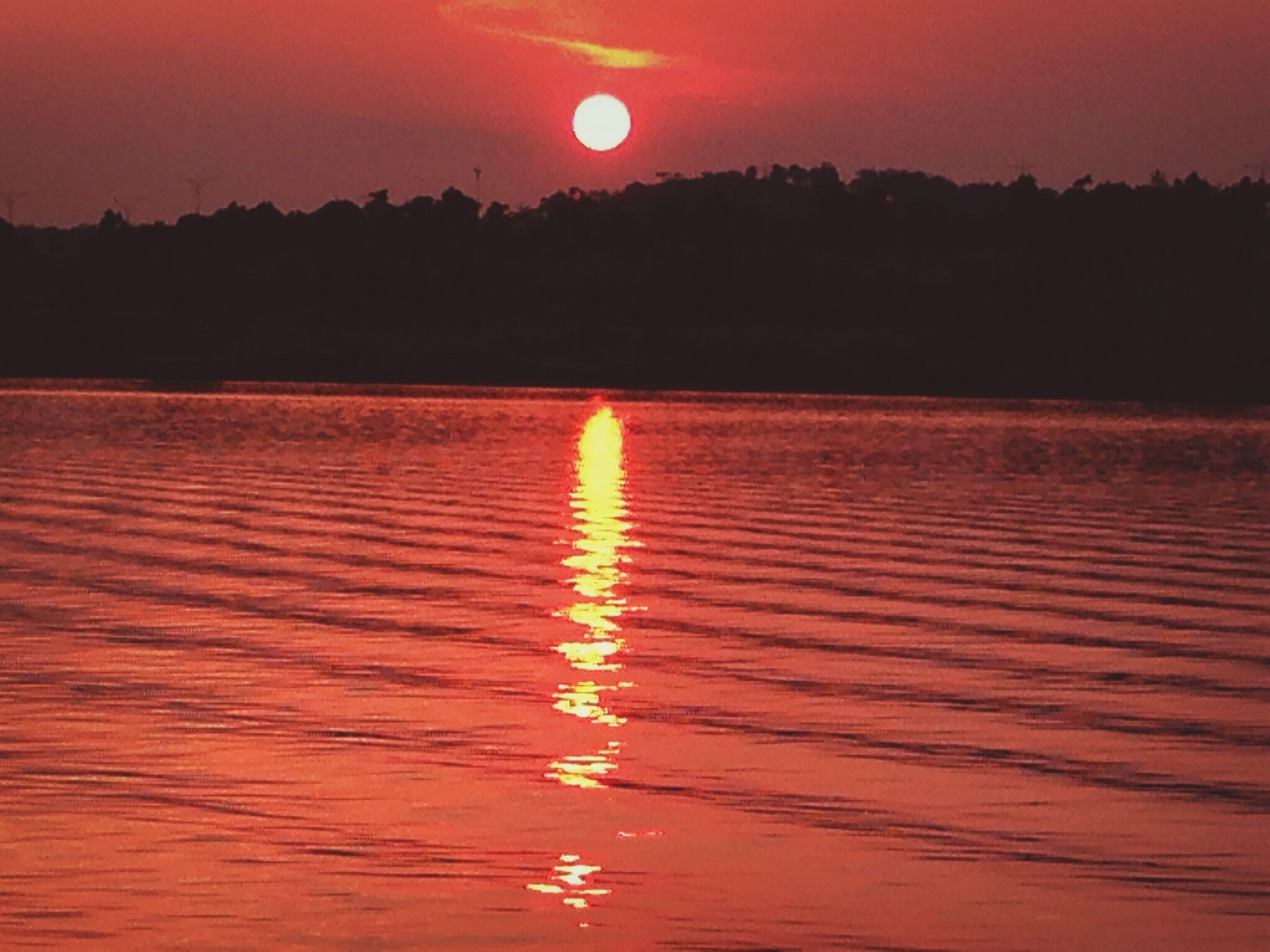 water, sunset, reflection, tranquil scene, scenics, tranquility, orange color, beauty in nature, sun, waterfront, red, idyllic, rippled, lake, sky, nature, silhouette, non-urban scene, outdoors, no people