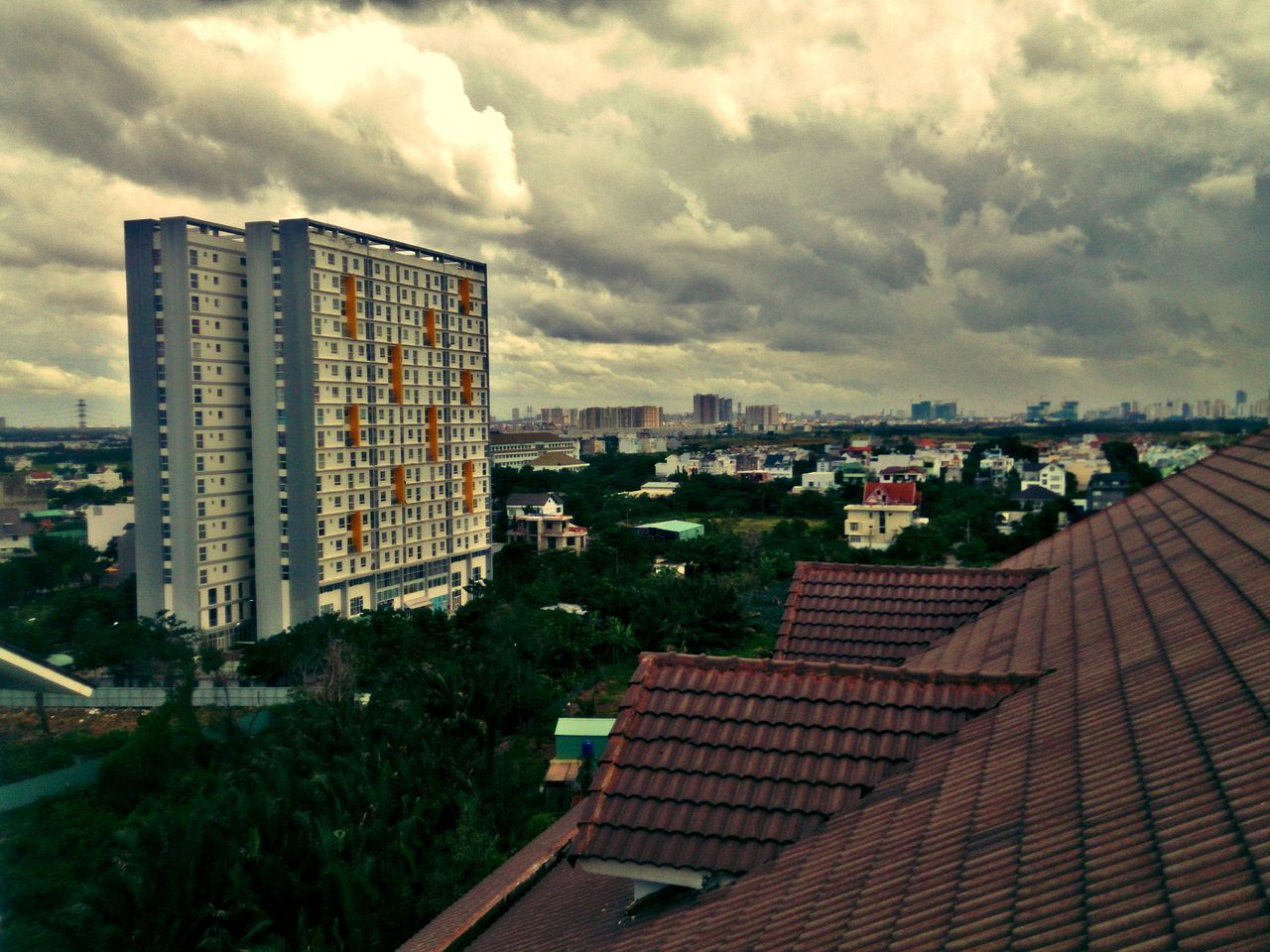 architecture, building exterior, built structure, sky, roof, cityscape, cloud - sky, city, no people, day, outdoors, tiled roof, residential