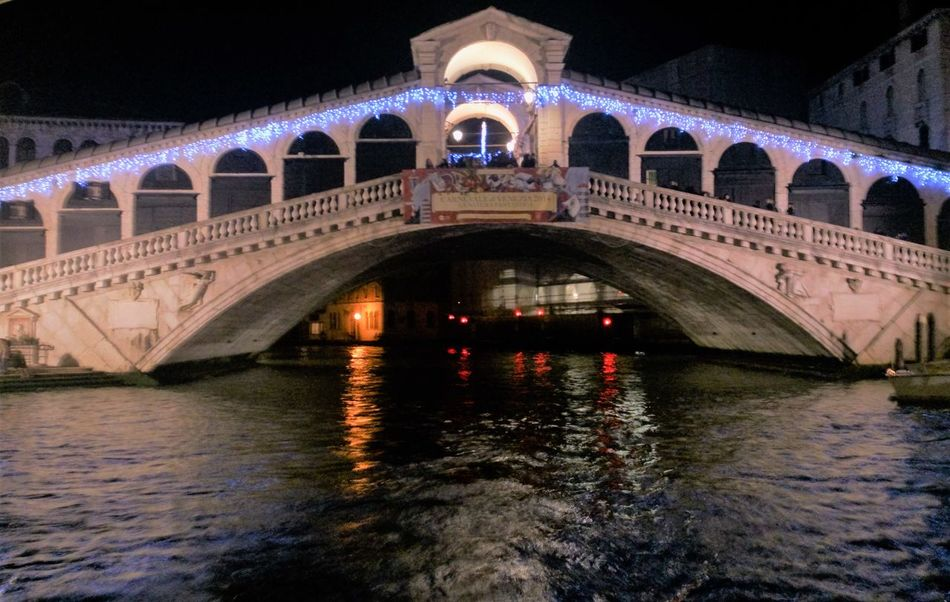 Arch Bridge Architectural Column Architecture Bridge - Man Made Structure Built Structure Canal City City Life Connection Diminishing Perspective Engineering Illuminated Multi Colored Night No People Outdoors Reflection Rialtobridge Rippled River Sky Tourism Travel Destinations Venice, Italy Water