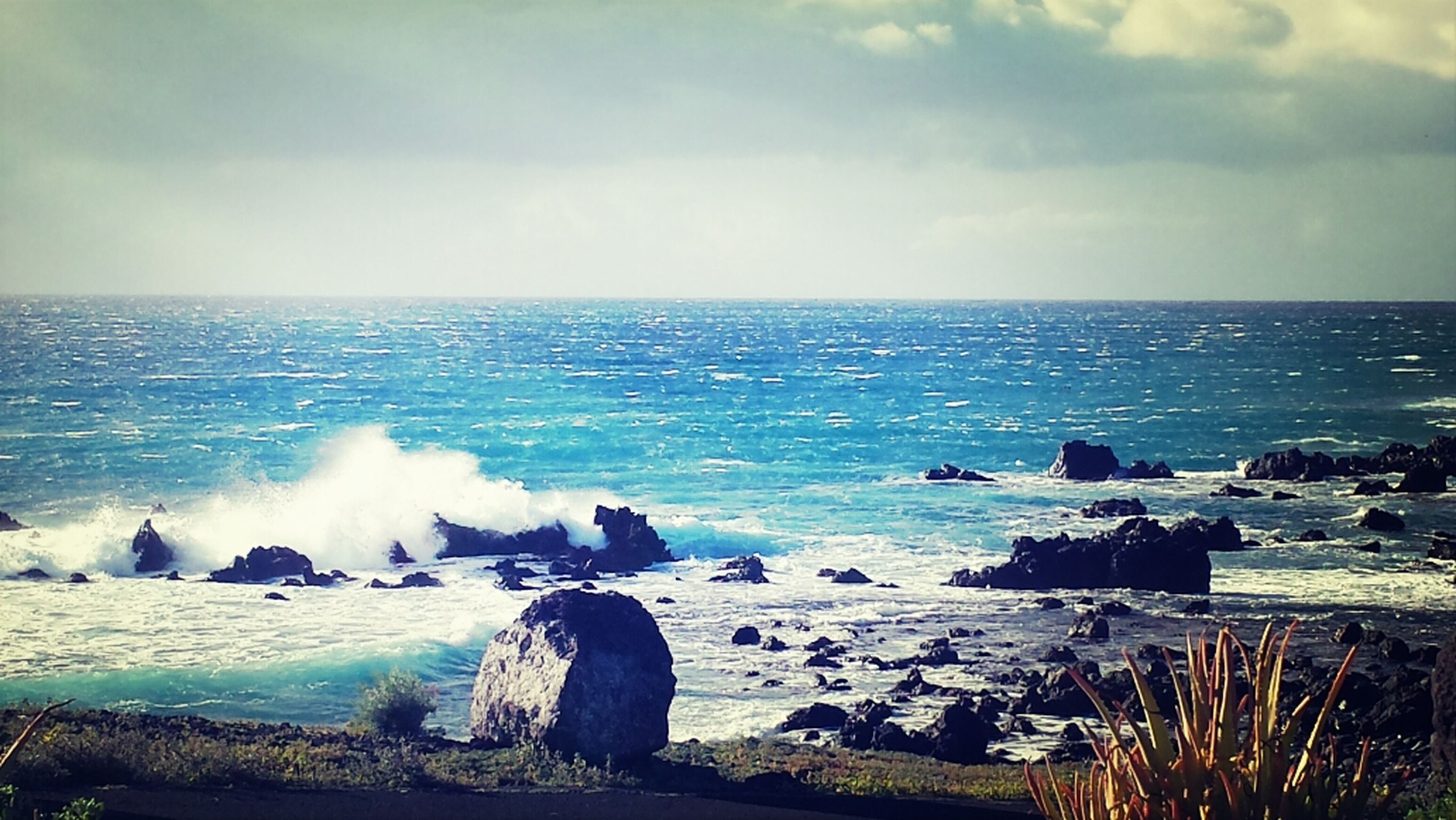 sea, horizon over water, water, sky, scenics, beauty in nature, rock - object, tranquil scene, tranquility, cloud - sky, nature, beach, shore, wave, idyllic, coastline, surf, cloud, remote, rock formation