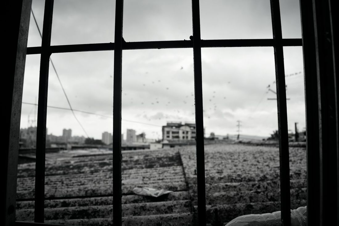 Window Rural Scene Landscape Window Indoors  No People Day Sky Grass Close-up Nature thane Outdoors Building Exterior Low Angle View Cloud - Sky City Travel Destinations