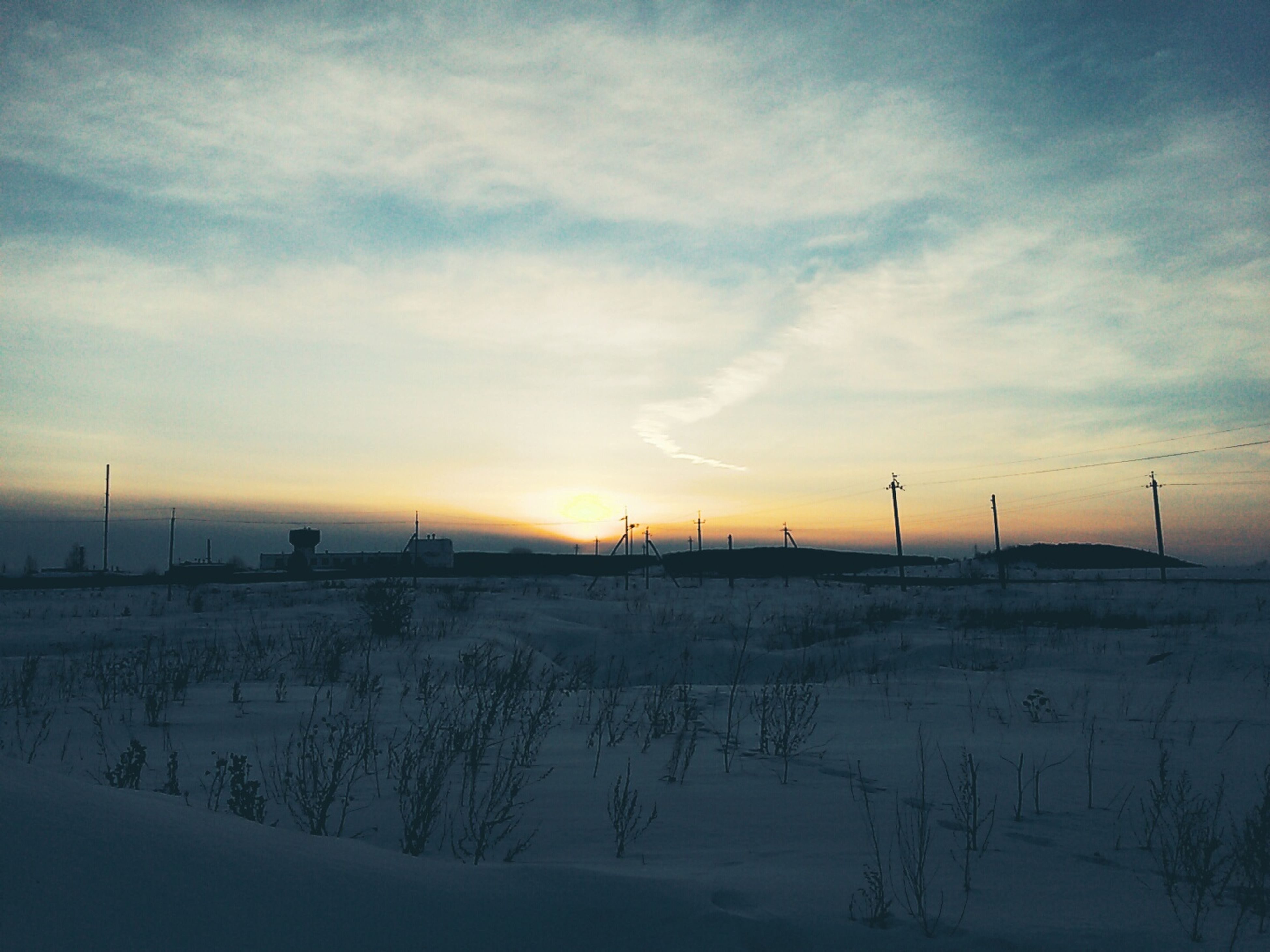 winter, snow, cold temperature, landscape, weather, tranquility, season, tranquil scene, field, sky, scenics, nature, sunset, beauty in nature, covering, cloud - sky, frozen, snow covered, rural scene, non-urban scene
