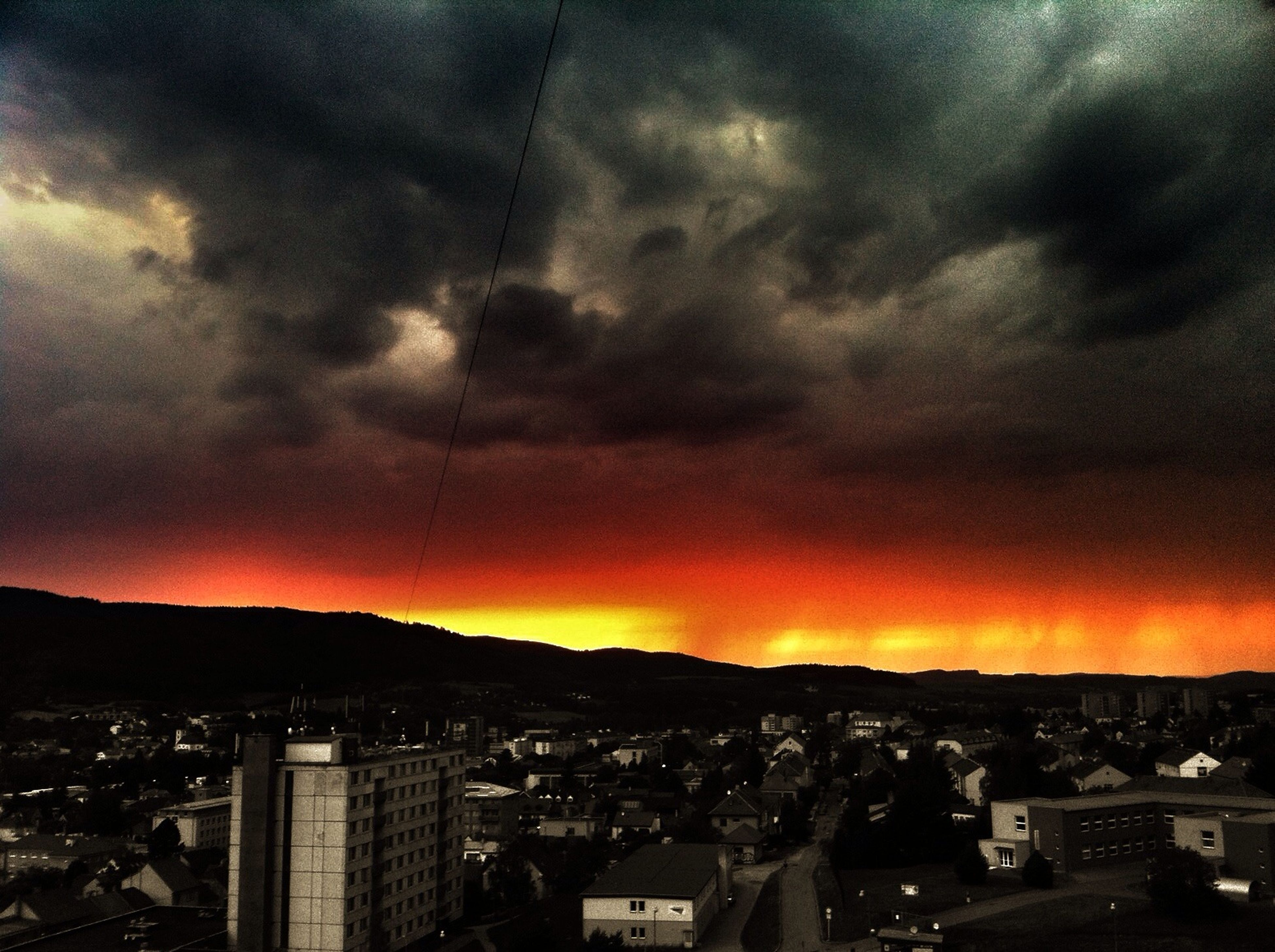 sky, sunset, cityscape, building exterior, cloud - sky, city, architecture, dramatic sky, built structure, cloudy, scenics, orange color, storm cloud, weather, overcast, silhouette, cloud, beauty in nature, dusk, atmospheric mood