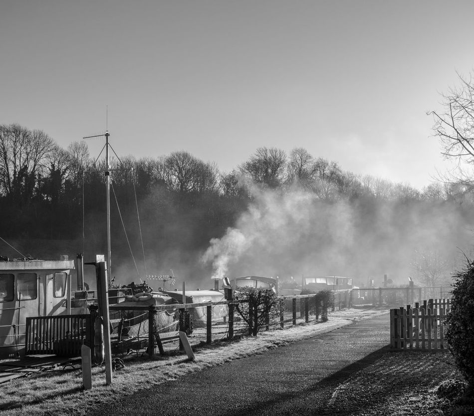 Boats moored at Kelston Lock on the River Avon, Saltford, Somerset. Barge Black And White Boat Cloud Cloud - Sky Cloudy Dusk Fuel And Power Generation Leading Monochrome Narrow Outdoors Overcast Pier Pole River Silhouette Sky Street Light Sunset The Way Forward Weather
