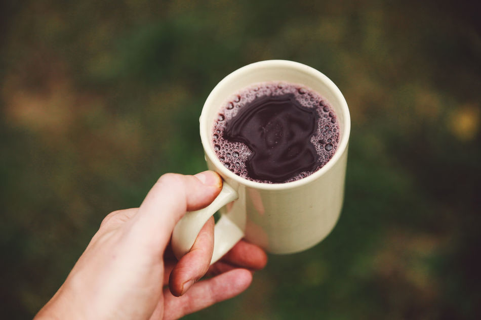Autumn Close-up Coffee Cup Cup Day Drink Focus On Foreground Food And Drink Freshness Grape Harvest Grape Juice Grapevine Holding Human Body Part Human Hand One Person Outdoors People Real People Refreshment Stum