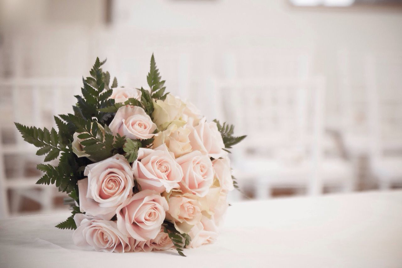 Bouquet Of Roses On Table At Wedding