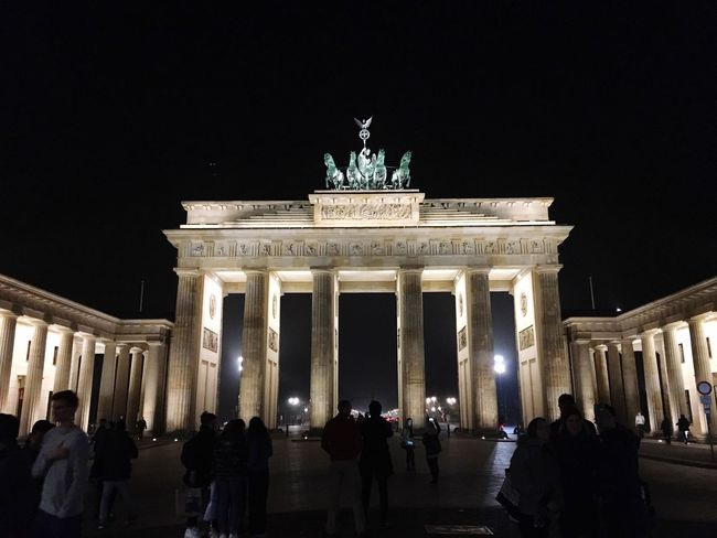 City Gate Architecture Night Travel Destinations City Tourism Architectural Column Statue Built Structure Sky Illuminated Sculpture Low Angle View Real People Outdoors Large Group Of People Triumphal Arch People Brandenburg Gate