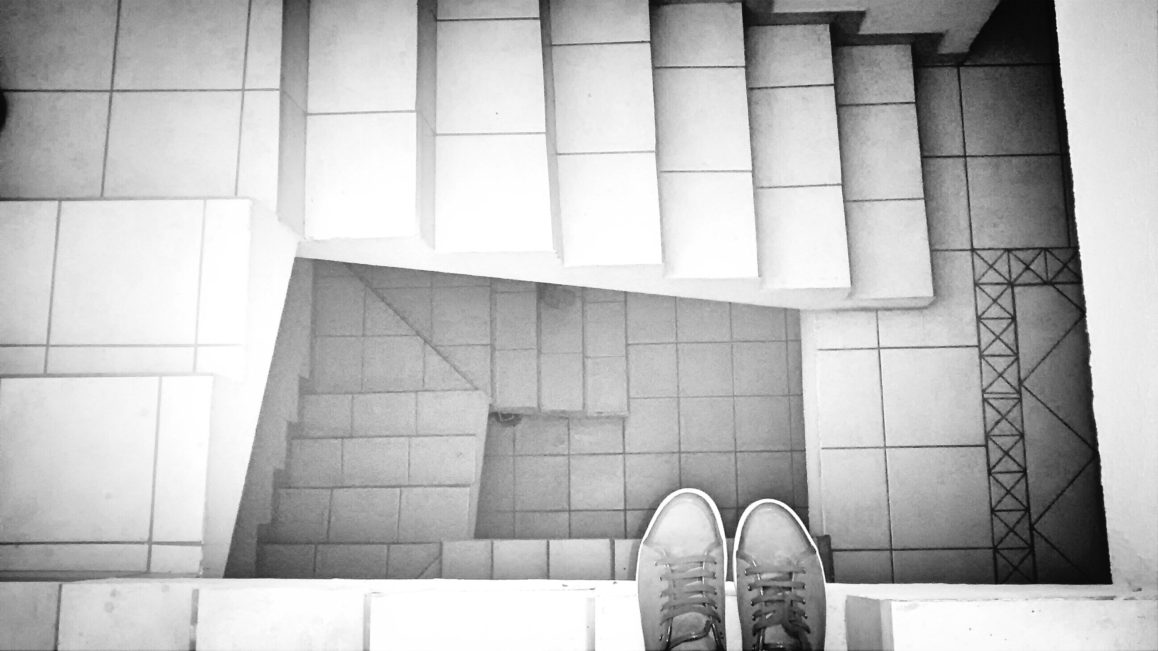low section, shoe, person, personal perspective, standing, footwear, human foot, men, indoors, architecture, lifestyles, unrecognizable person, part of, built structure, tiled floor, high angle view, day