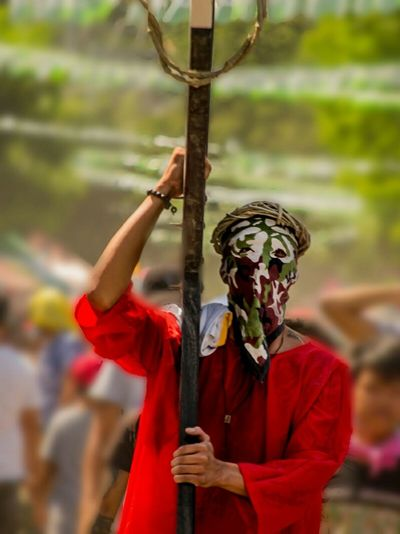 """A man from angeles city Pampanga Philippines is practicing """"penitensya"""". This is done by carrying a cross during friday of Holy Week. Tradition People Cultures Focus On Foreground Outdoors Waist Up Day Noontime  Facecovered Cross Penitensya Holyweek2017 Angeles City, Pampanga Philippines ❤️ Tradition Carrying His Cross"""