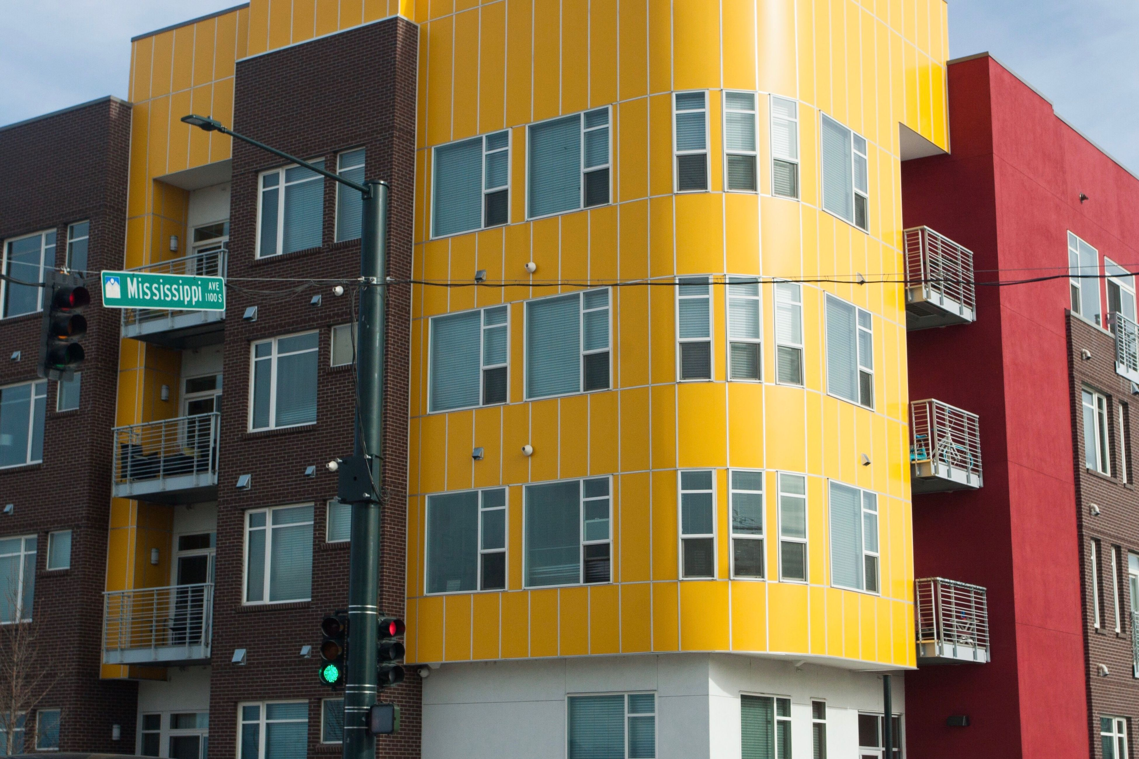 building exterior, architecture, window, city, city life, built structure, apartment, yellow, no people, outdoors, multi colored, modern, skyscraper, downtown district, day