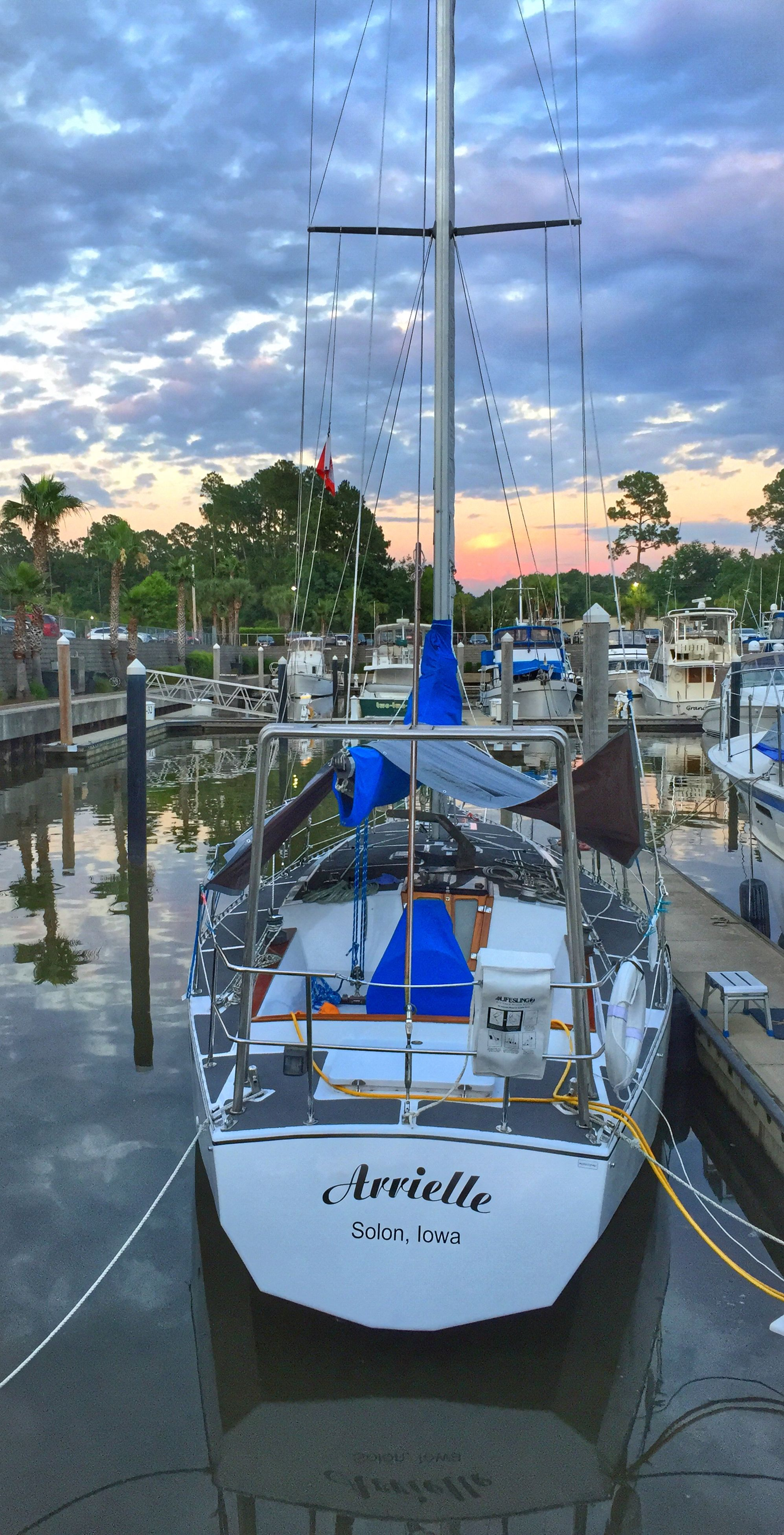 nautical vessel, transportation, sky, mode of transport, moored, boat, water, cloud - sky, mast, cloud, sailboat, sea, cloudy, harbor, travel, nature, reflection, tranquility, outdoors, river