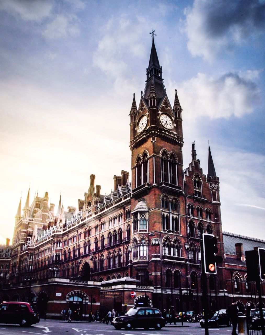 architecture, building exterior, sky, built structure, clock tower, cloud - sky, tower, travel destinations, outdoors, city, history, day, no people