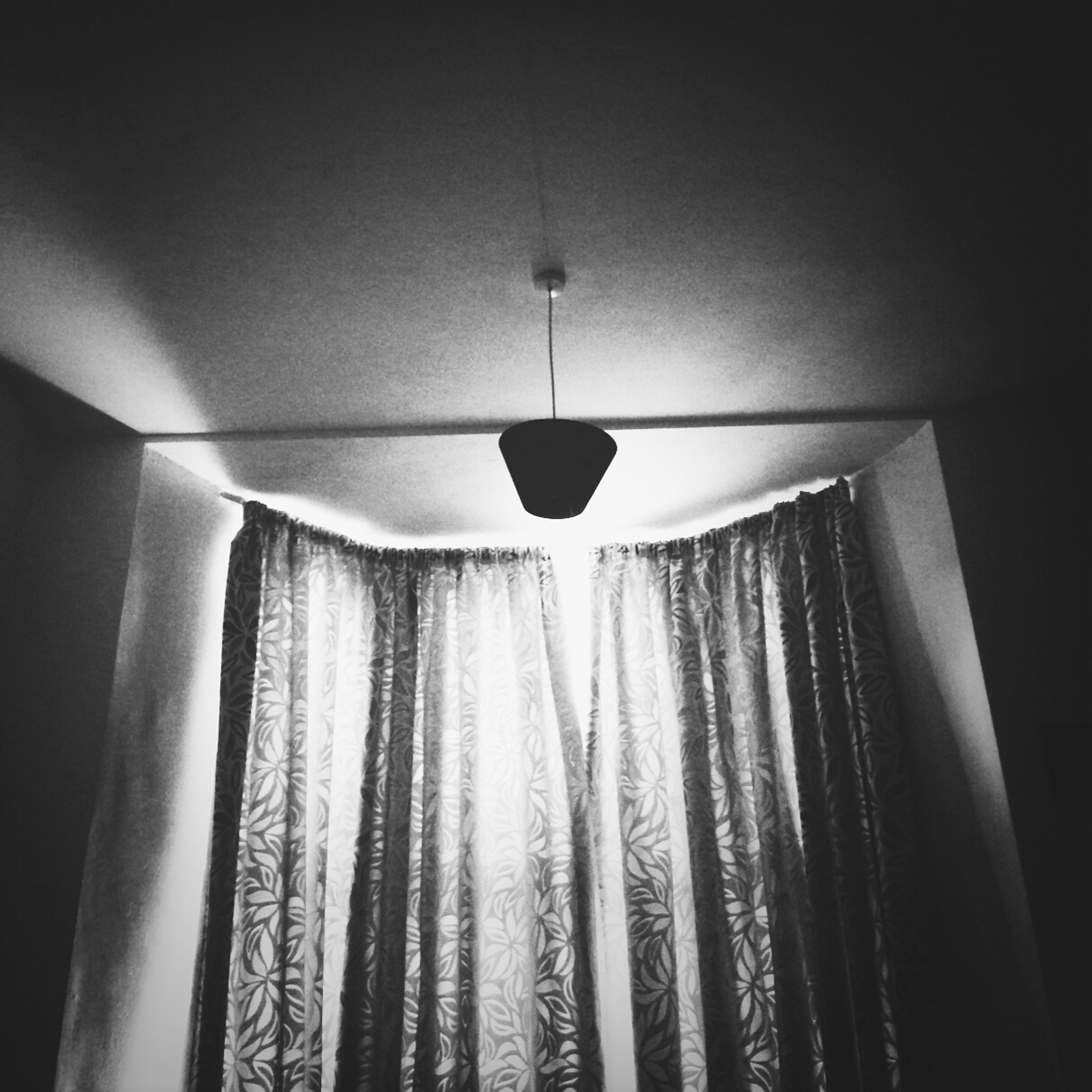 indoors, lighting equipment, ceiling, illuminated, hanging, low angle view, electricity, electric lamp, electric light, chandelier, decoration, lamp, light - natural phenomenon, light bulb, decor, home interior, glowing, pendant light, no people, wall - building feature