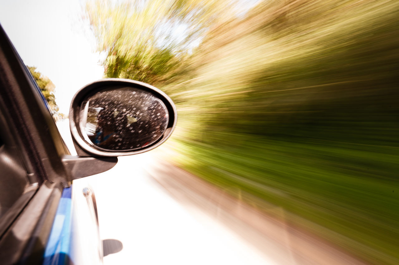 transportation, car, mode of transport, journey, land vehicle, speed, tree, day, blurred motion, close-up, no people, nature, motion, outdoors, sky