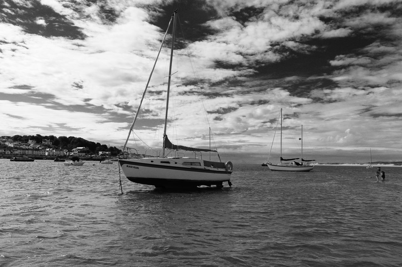 nautical vessel, transportation, mode of transport, water, sky, cloud - sky, boat, moored, nature, waterfront, outdoors, sea, mast, scenics, tranquility, day, beauty in nature, no people, sailboat, sailing