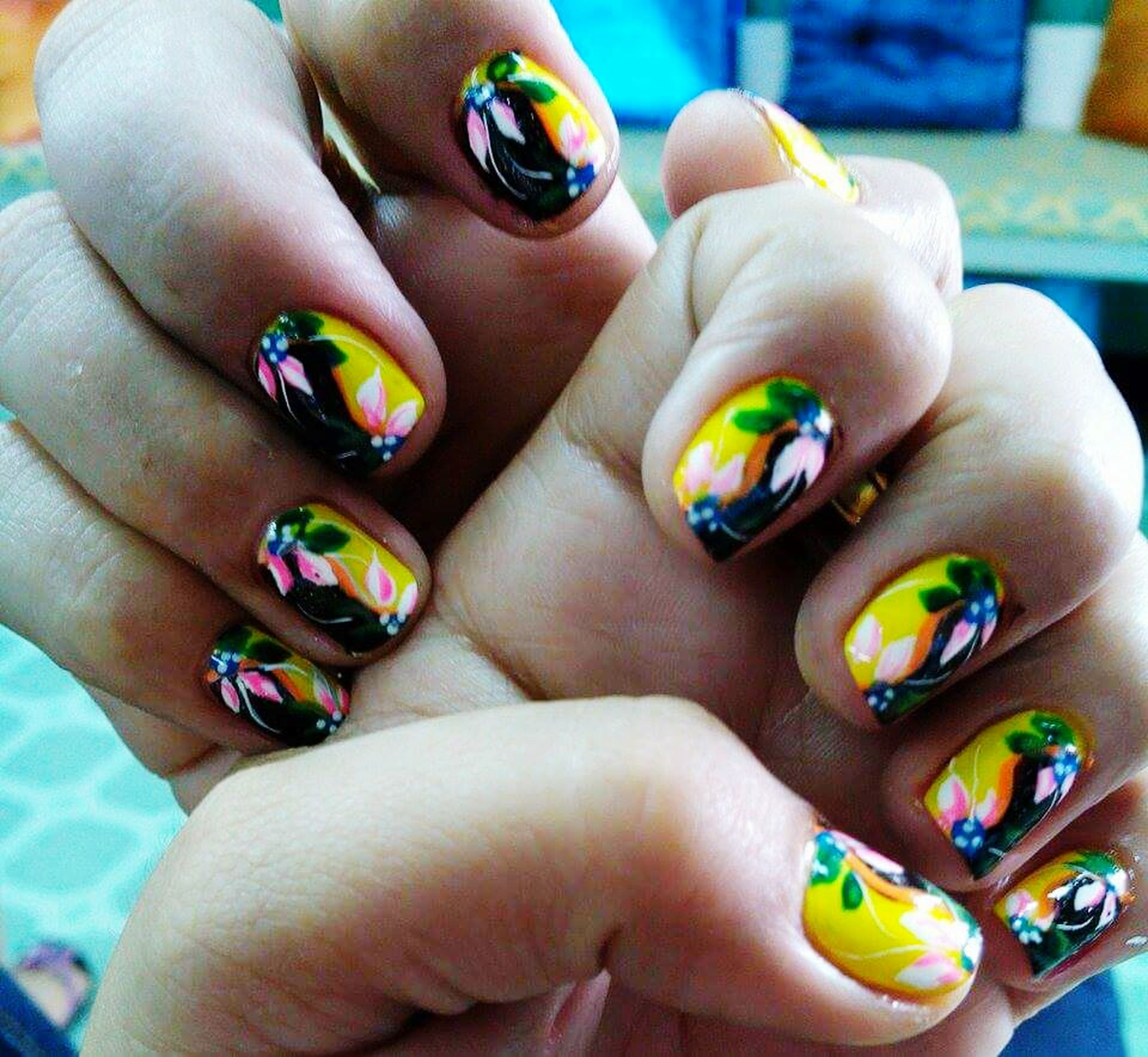 person, part of, holding, human finger, cropped, lifestyles, unrecognizable person, leisure activity, multi colored, close-up, showing, focus on foreground, personal perspective, high angle view, toy, nail polish