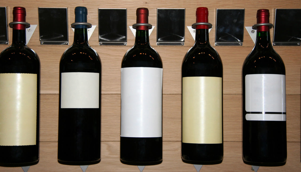 five famous wines in a store - saint-emilion, france Alcohol Arrangement Blank Label Bodeaux Bottle Cellar Château Cork - Stopper Drink Five France In A Row Liquor Merlot No People Red Wine Saint-Emilion Shop Small Group Of Objects Store Wine Wine Bottle Wine Rack Winery Winetasting