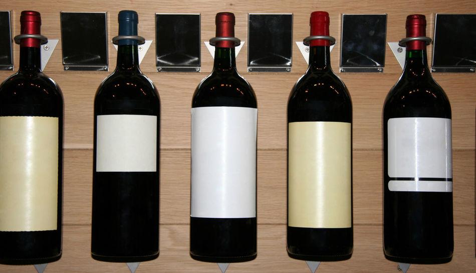 five famous wines in a store - saint-emilion, france Alcohol Arrangement Blank Label Bodeaux Bottle Cellar Château Cork - Stopper Drink Five France In A Row Liquor Merlot No People Red Wine Saint-Emilion Shop Small Group Of Objects Store Wine Wine Bottle Wine Rack Winery Winetasting