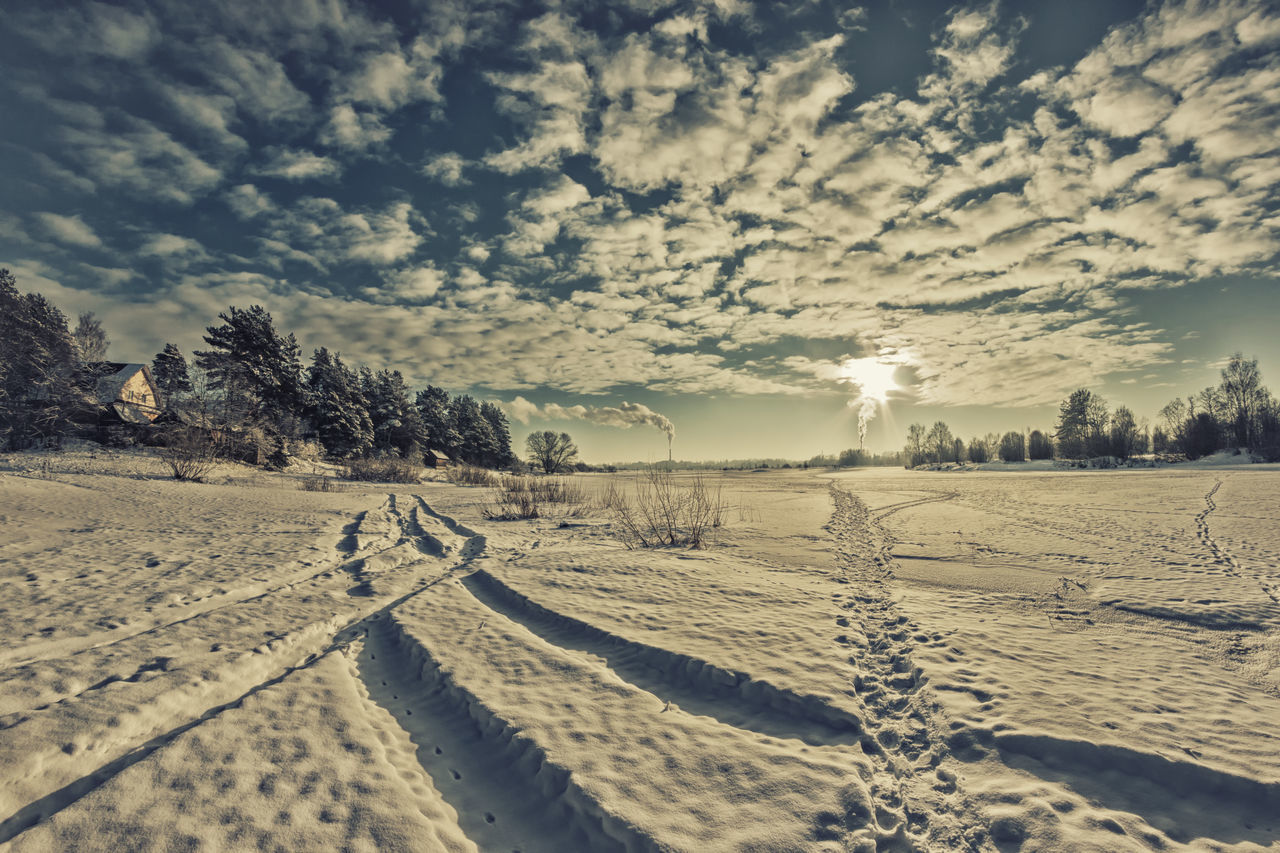 Frosty day on the river. Rural landscape, the river under the ice and snow. Beauty In Nature Cloud - Sky Cold Temperature Environment Extreme Weather Landscape Nature No People Outdoors Snow Tree Weather Winter