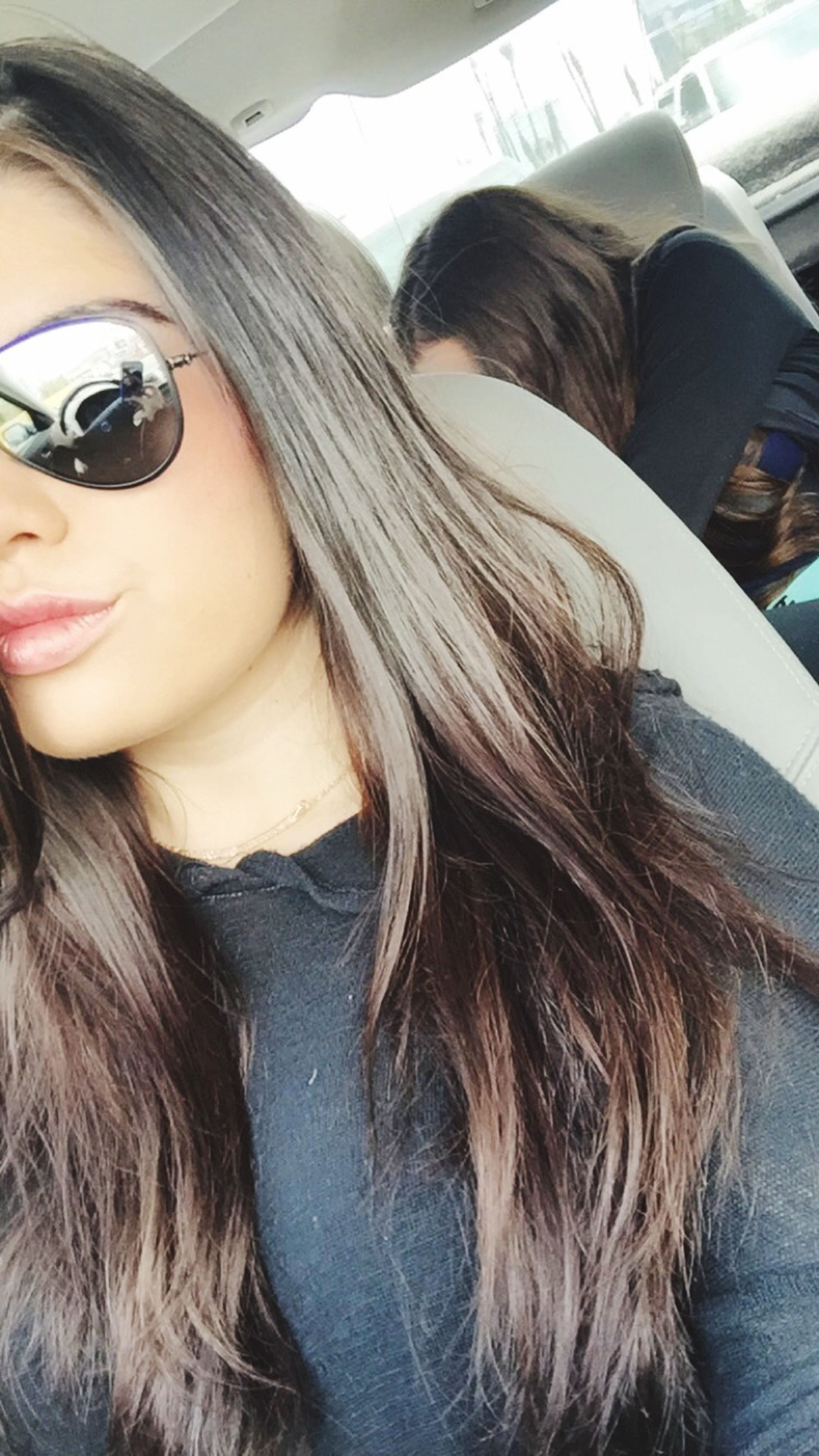 young adult, young women, person, lifestyles, long hair, headshot, leisure activity, looking at camera, portrait, smiling, front view, sunglasses, casual clothing, black hair, indoors, blond hair, close-up