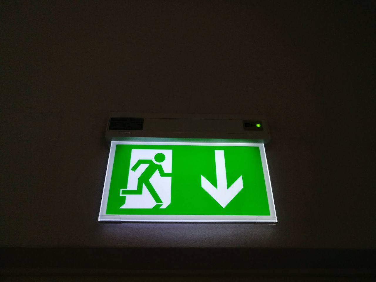 Directional Sign Exit Sign Emergency Exit Safety Arrow Symbol Guidance Urgency Green Color Illuminated Danger Leaving Protection Advice Communication Instructions Get Out
