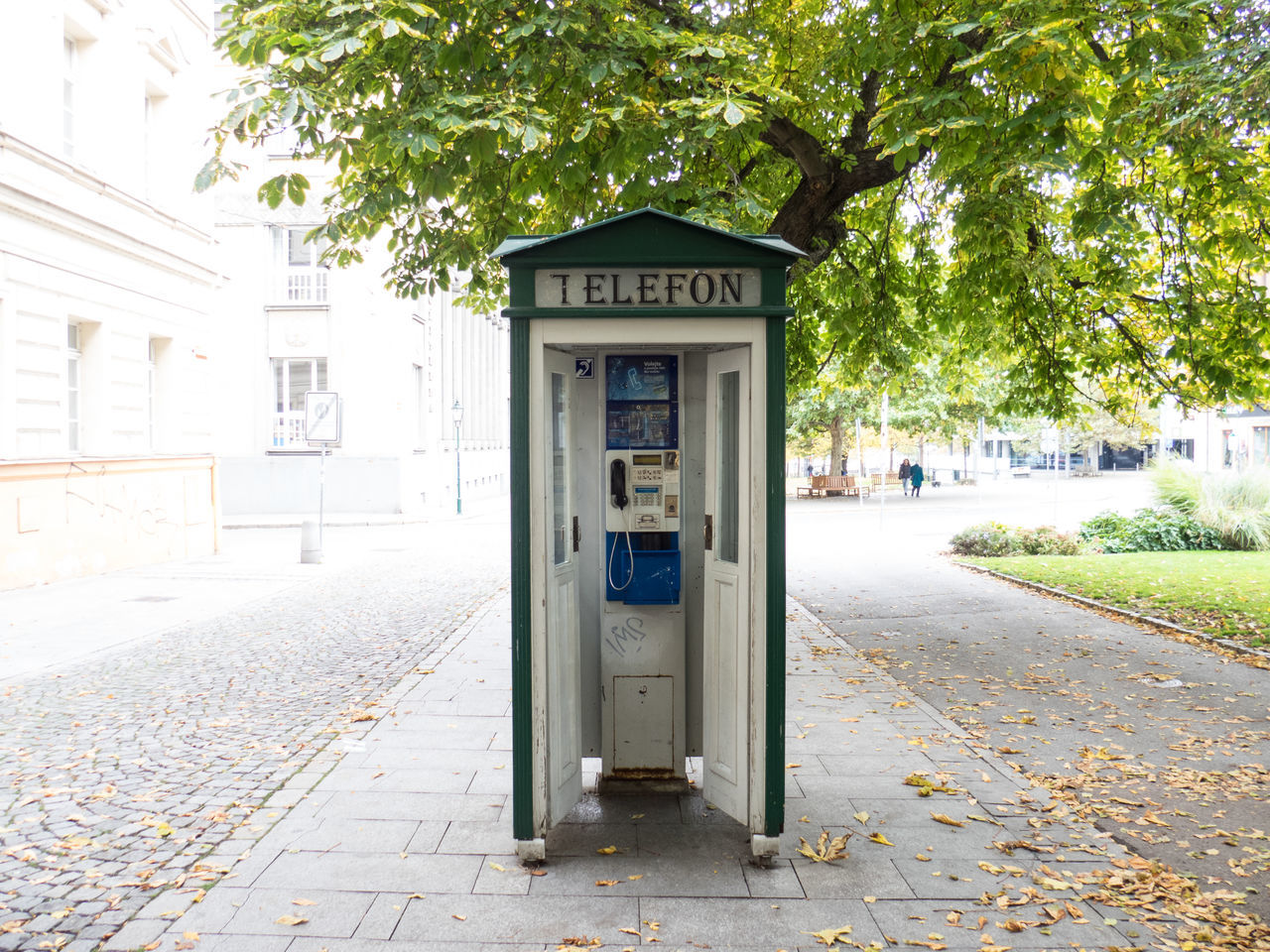 communication, built structure, architecture, tree, telephone booth, building exterior, pay phone, day, outdoors, no people, street